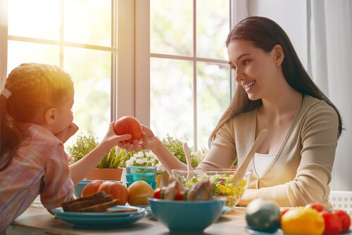 mother and child eating healthy filling meal
