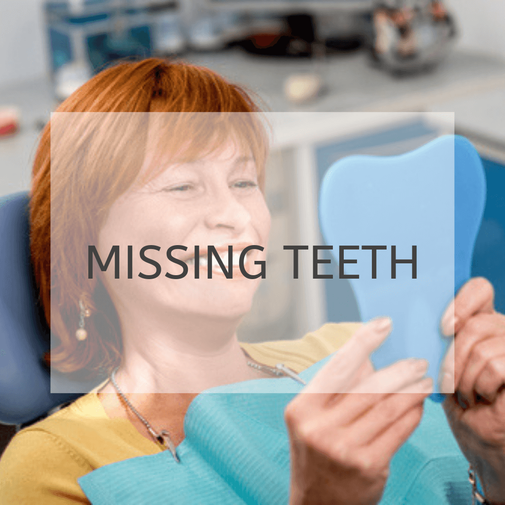 "woman with dental implants looking in mirror and smiling with the text ""missing teeth"""