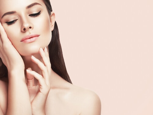 beautiful woman with smooth skin after cosmetic procedure