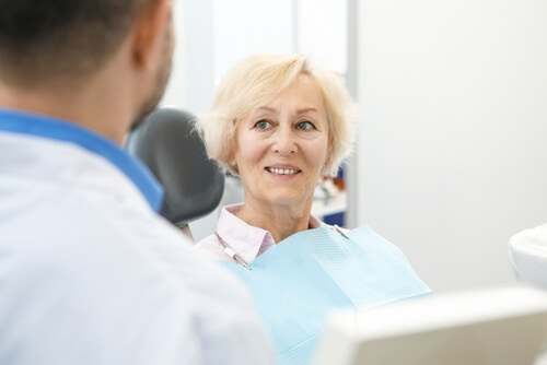 older woman at dental appointment for restorative dental treatment